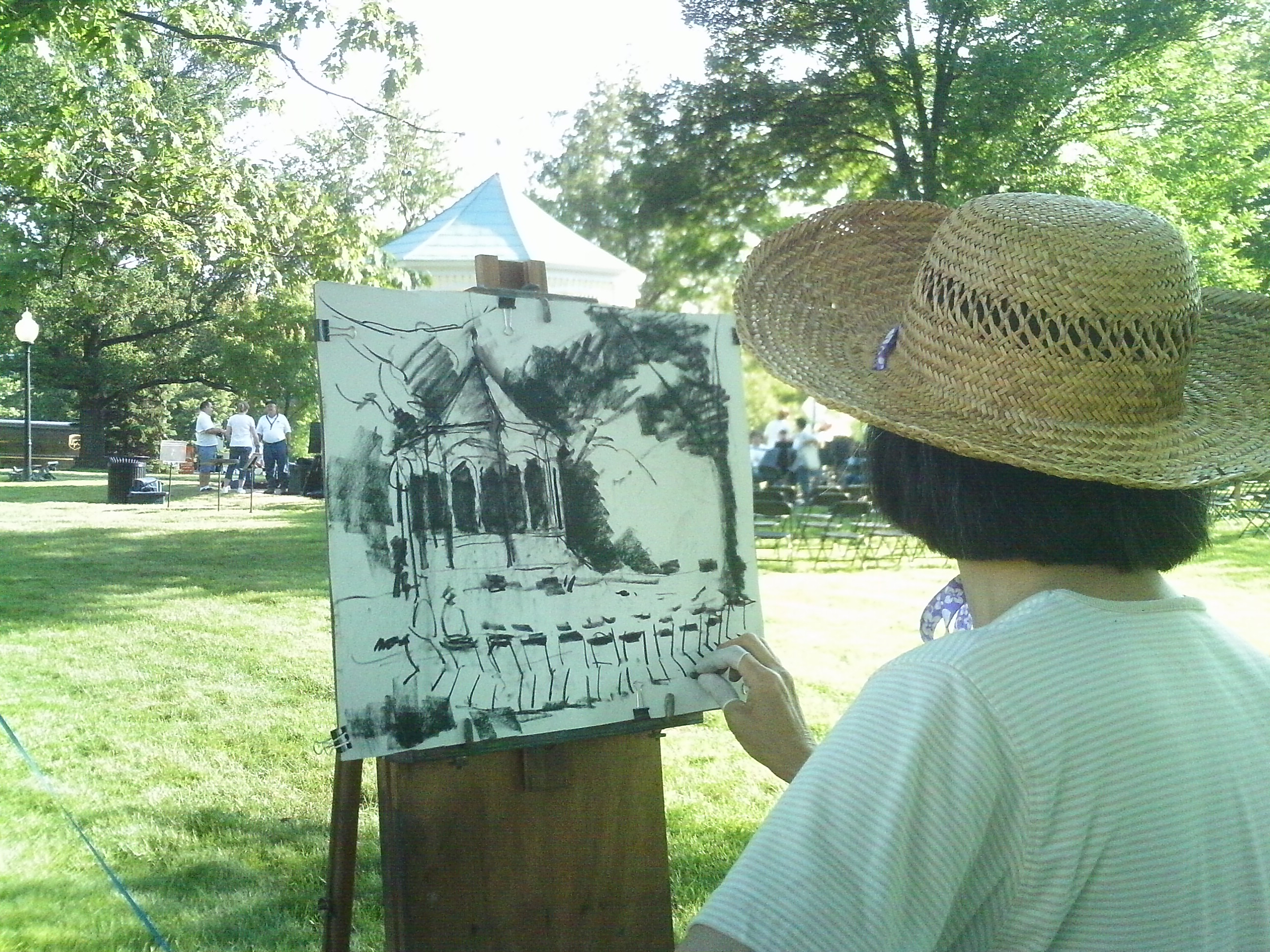 Artist Mina Huang painting at the ICS Quick Draw auction